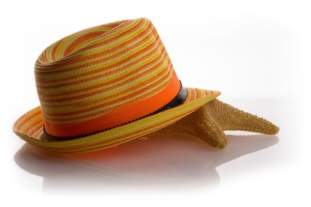 Starfish lying under a straw hat Stock Photo - 21091161