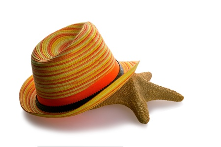 Beach hat and starfish isolated on white background photo