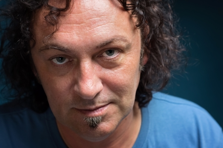 Portrait of a middle-aged man with dark curly hair  Stock Photo - 22142589