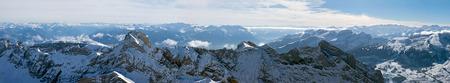 Panoramic photo of a mountain range in Switzerland with bird
