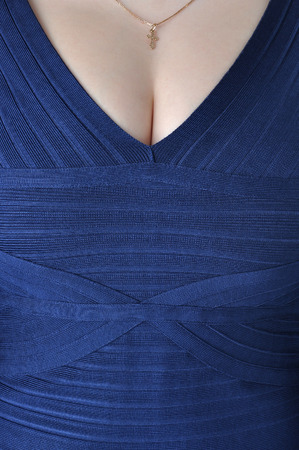 Item of womens clothing, neck blue dress closeup