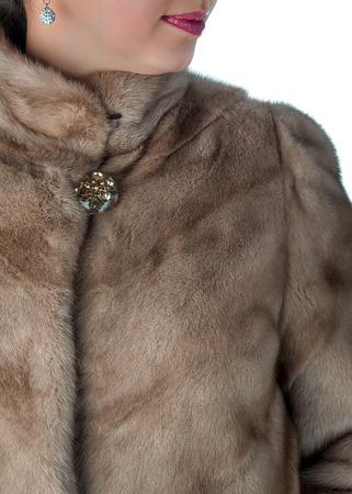 Fragment of female mink fur coats beige