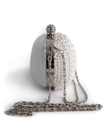 White handbag on a chain decorated with pearls, isolated on a white background.