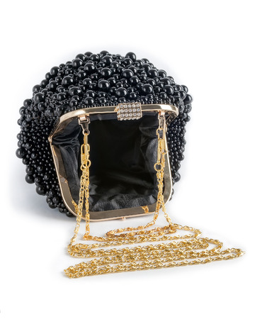 Black handbag on a chain decorated with pearls, isolated on a white background. Stock Photo