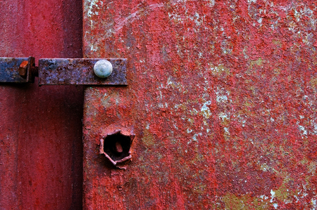 Old painted metal construction in red.