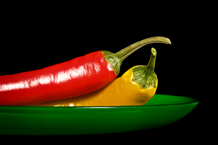 Chile pepper pods on a glass dish green