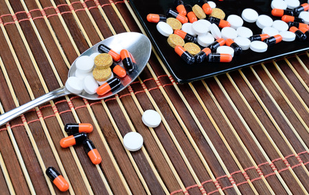 pill on wooden table