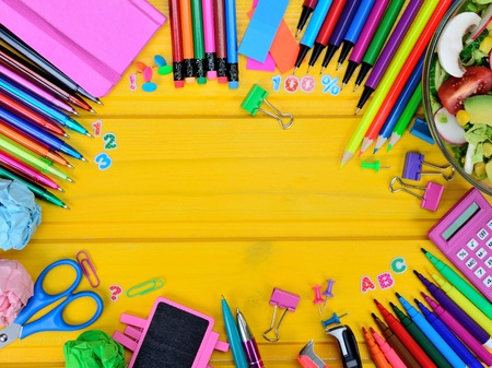 supplies for school on yellow wooden table