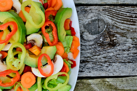 tabel: salad in white dish on wooden tabel Stock Photo