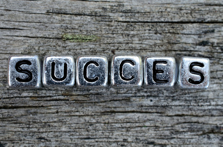 succes: cube word succes on wooden table
