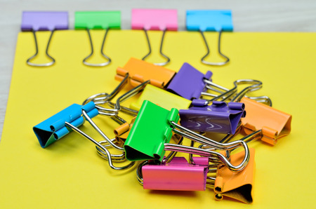 clamp: color clamp on yellou paper and attach Stock Photo