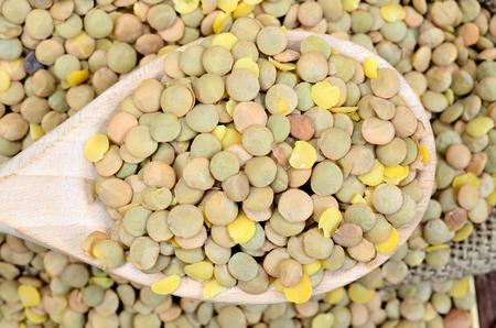 green lentil: green lentil in wooden spoon