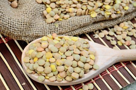 green lentil: green lentil in spoon on wooden table
