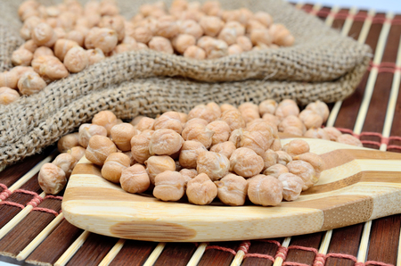 chickpea in wooden spoon on table