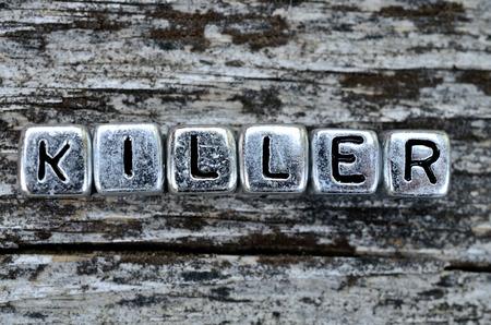 killer: cube word killer on wooden table