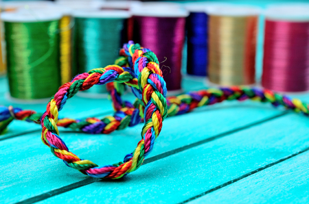 vibrant color: vibrant color thread on blue wooden table