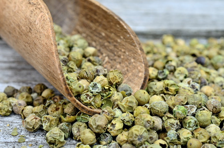 peppercorn: green peppercorn on wooden table Stock Photo