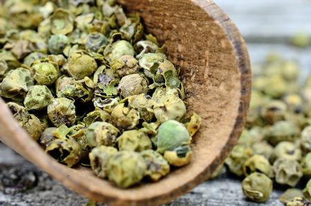 peppercorn: green peppercorn in scoop on wooden table