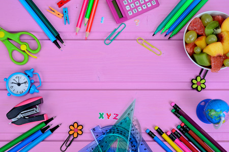 supplies for school on pink wooden table Stock Photo