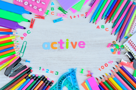 word active colors letters and objects for school on gray wooden table