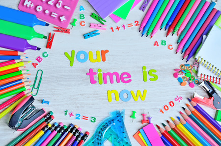 word color letter your time is now on gray wooden table