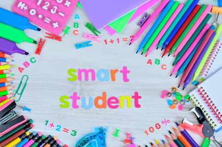 word smart student colors letters and stuff for school on gray wooden table