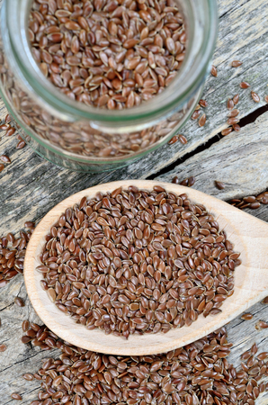 linseed: linseed in wooden spoon on wooden table