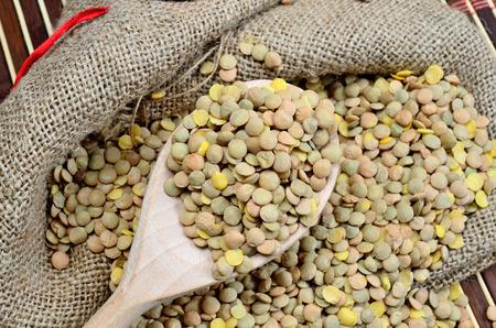green lentil: green lentil in wooden spoon on sack