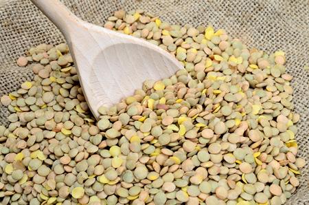 green lentil: green lentil on sack with wooden spoon