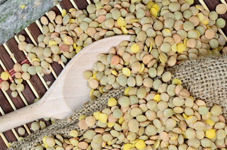 green lentil: green lentil on table with sack and spoon
