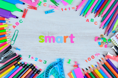 word smart color letter and stuff for school on gray wooden table Stock Photo