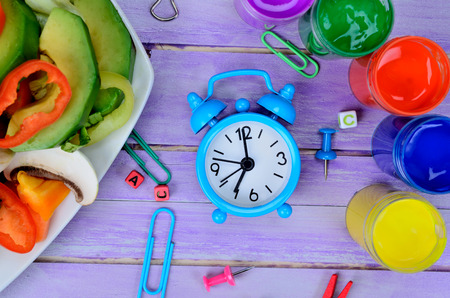 clue: clue clock with salad on purple wooden table