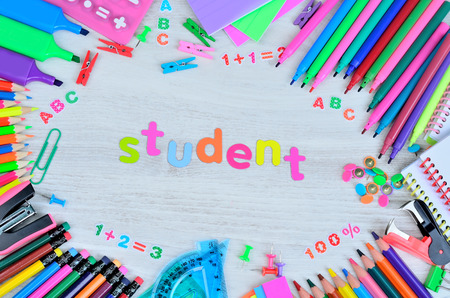 engrapadora: word student colors letter and object for school on gray wooden table