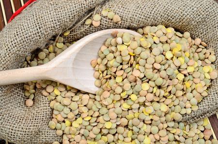 green lentil: green lentil in sack on table