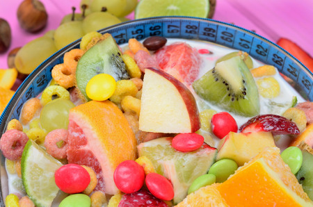 cereal with fruit on pink wooden table