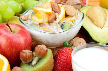 cereal with fruit on wooden table Stock Photo