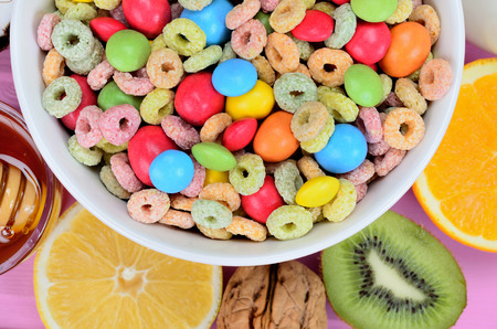 cereal with candy on pink table Stock Photo