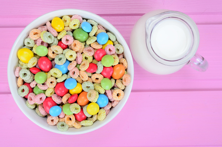 cereal with candy on pink wooden table Stock Photo