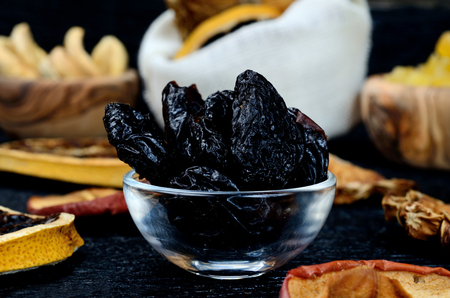 dried fruits on black wooden table