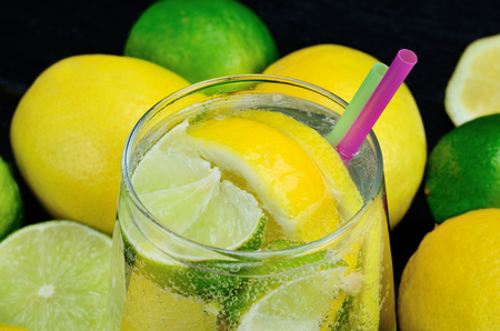 glass of water with lemon and lime for detox on  table