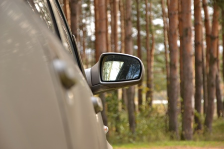 Automobile right lateral mirror against the nature photo