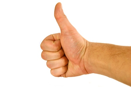man's thumb: Fist with a thumb lifted upwards on a white background