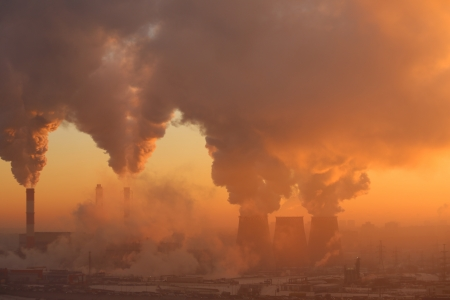discharge: Polluting factory at dawn Stock Photo