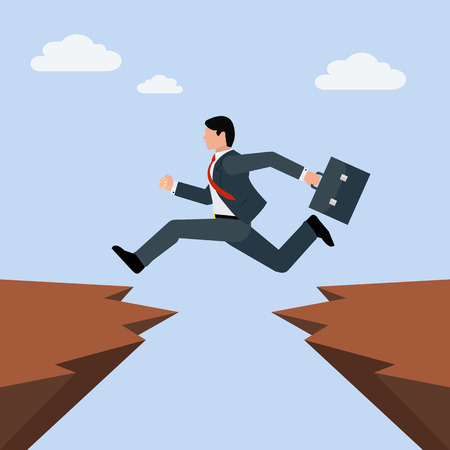 Man in business suit jumps from one rocky cliff to another, overcoming obstacles in business concept