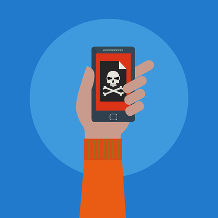 Hand holding a mobile phone with a skull symbol on the screen, virus, hacker attack vector concept