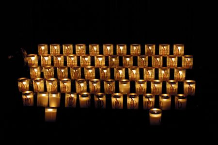 love dome: The many candles with Madonna inside Notre Dame. Paris Stock Photo