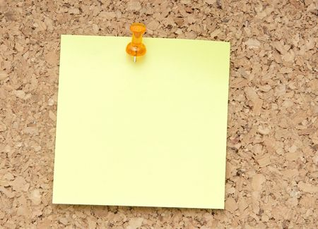 corkwood: green reminder note with orange pin on corkboard