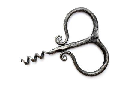 Old vintage corkscrew on a white background