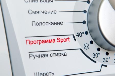 turning operation: Washing machine program dial (russian) close-up