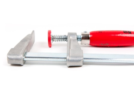 vice: Metal vice with red handle on white background Stock Photo